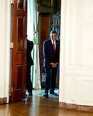 United States President Barack Obama departs the Green Room to deliver remarks at a naturalization ceremony for active duty service members in the East Room of the White House in Washington, D.C. on Wednesday, July 4, 2012..Credit: Ron Sachs / Pool via CNP
