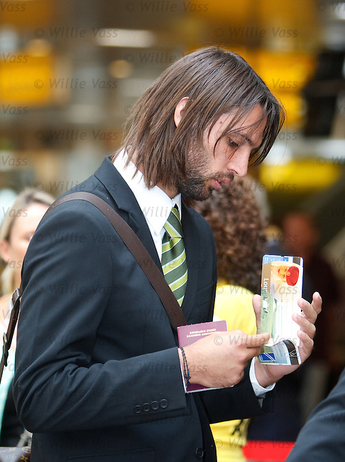 Georgios Samaras checks to see who he is sitting next to and is not amused