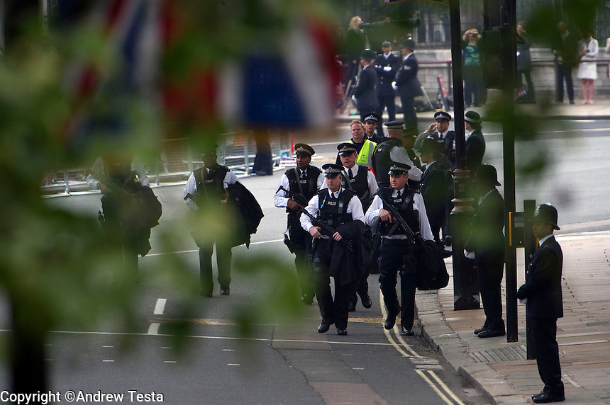 UK. London. 29th April 2011..Armed police patrol near Westminster Abbey.©Andrew Testa for the New York Times..