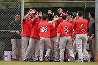 Illinois State Redbirds Jack Czeszewski (25) high fives teammates after scoring a run during a game against the Georgetown Hoyas on March 7, 2015 at North Charlotte Regional Park in Port Charlotte, Florida.  Illinois State defeated Georgetown 2-1.  (Mike Janes/Four Seam Images)