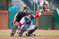 Hagerstown Suns catcher Spencer Kieboom (20) catches a high pitch as home plate umpire Zach Tieche looks on during the game against the Greensboro Grasshoppers at NewBridge Bank Park on June 21, 2014 in Greensboro, North Carolina.  The Grasshoppers defeated the Suns 8-4. (Brian Westerholt/Four Seam Images)