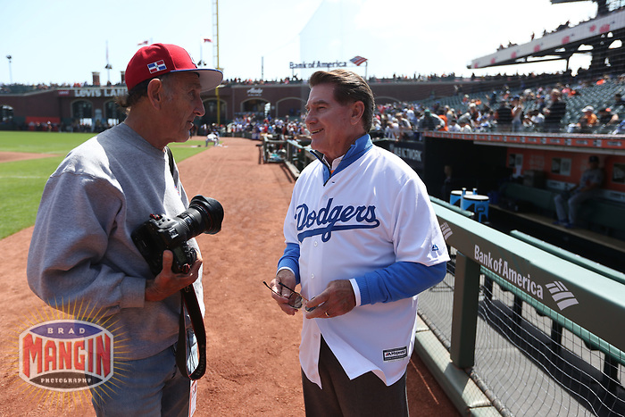 SAN FRANCISCO, CA - APRIL 8:  Photographer Michael Zagaris talks to Steve Garvey of the Los Angeles Dodgers before the game against the San Francisco Giants at AT&T Park on Sunday, April 8, 2018 in San Francisco, California. (Photo by Brad Mangin)