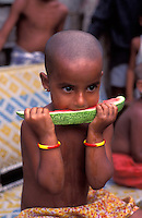 Bangladesh, Dhaka, 1991..Child eating watermellon...Kind eet watermeloen...Photo Kees Metselaar