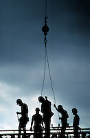ROAD CONSTRUCTION WORKERS IN SILHOUETTE