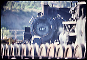 Very blurred photo of D&amp;RGW #487 K-36 with row of wheels in foreground.<br /> D&amp;RGW