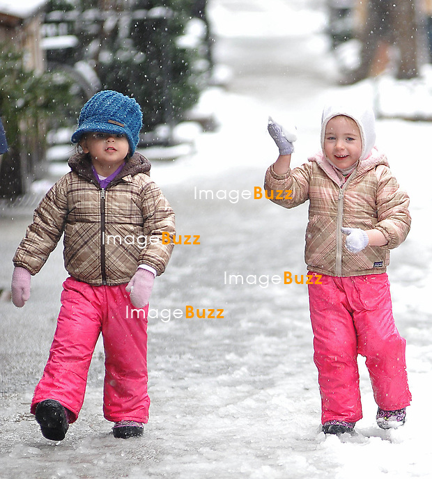 Sarah Jessica Parker's Twins, Tabitha & Marion, Catch Snowflakes in New York, on March 8, 2013.