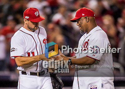 13 October 2016: Former Washington Nationals pitcher Livan Hernandez receives the first pitch ball from Ryan Zimmerman prior to Game 5 of the NLDS against the Los Angeles Dodgers at Nationals Park in Washington, DC. The Dodgers edged out the Nationals 4-3, to take Game 5 of the Series, 3 games to 2, and move on to the National League Championship Series against the Chicago Cubs. Mandatory Credit: Ed Wolfstein Photo *** RAW (NEF) Image File Available ***
