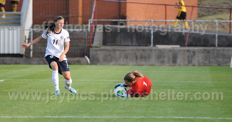 Hannah Blundell of England puts French goalkeeper Solene Durand under pressure during the UEFA Womens U19 Championships at Stebonheath Park, Llanelli  Monday 19th August 2013. All images are the copyright of Jeff Thomas Photography-www.jaypics.photoshelter.com-07837 386244-Any use of images must be authorised by the copyright owner.