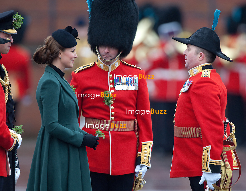 CATHERINE, DUCHESS OF CAMBRIDGE_AND PRINCE WILLIAM.attend the St. Patrick's Day Parade at Mons Barracks, Aldershot_17/03/2013.Prince William attended as Colonel of the Regiment while Kate presented the traditional sprigs of shamrock to the Officers and Guardsmen