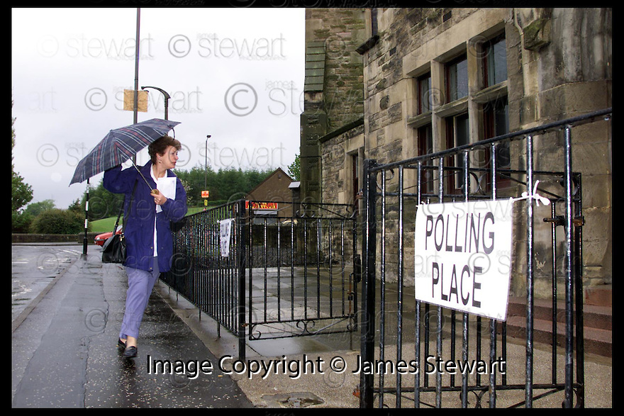 6th May 99                        Copyright Pic : James Stewart .Ref :                           .File Name : stewart02-scottish elections                        .VOTING FOR THE SCOTTISH ELECTION GOT OFF TO A WET START IN THE SEAT OF FALKIRK WEST........Payments to :-.James Stewart Photo Agency, Stewart House, Stewart Road, Falkirk. FK2 7AS      Vat Reg No. 607 6932 25.Office : 01324 630007        Mobile : 0421 416997.E-mail : JSpics@aol.com.If you require further information then contact Jim Stewart on any of the numbers above.........