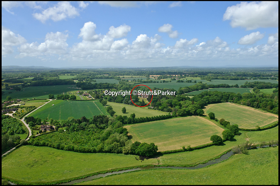 BNPS.co.uk (01202 558833)Pic: Strutt&Parker/BNPS<br /> <br /> Circled in red is Lock House.<br /> <br /> Homebuyers will need to be Rolling In The Deep pockets to buy this stunning country manor that popstar Adele once lived in.<br /> <br /> The award-winning singer rented Lock House in Partridge Green, West Sussex, which is now on the market with Strutt & Parker for £7.25m, in 2011 and 2012.<br /> <br /> The glamorous 13-bedroom property is very much as it would have been when Adele lived there and would appeal to celebrities as it comes with a helicopter hangar and almost 85 acres of land, making it very private.<br /> <br /> Adele rented the grand home for about £15,000 a month and famously gave US TV host Anderson Cooper, presenter of 60 Minutes, a guided tour of the mansion in 2012.