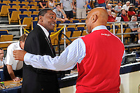 21 January 2012:  FIU Head Coach Isiah Thomas shakes hands with FAU Head Coach Mike Jarvis prior to the game.  The Florida Atlantic University Owls defeated the FIU Golden Panthers, 66-64, at the U.S. Century Bank Arena in Miami, Florida.