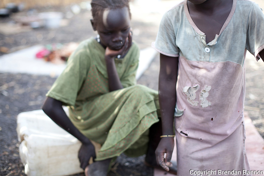 Children  of Nyabok Yien, displaced in March 2012 by fighting between Nuer and Muerle in Akobo, South Sudan. They fled to safety in Nasir where they stay with Mary Chuol an aunt.