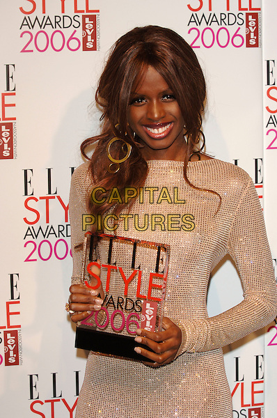 JUNE SARPONG.Elle Style Awards 2006.The Old Truman Brewery, Brick Lane.London, England.20th February 20th, 2006..half length holding award trophy gold shiny sequined dress.Ref:PL.www.capitalpictures.com.sales@capitalpictures.com.©Phil Loftus/Capital Pictures.