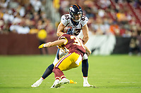 Landover, MD - August 24, 2018: Denver Broncos tight end Matt LaCosse (83) breaks the tackle of Washington Redskins defensive back Troy Apke (30) during preseason game between the Denver Broncos and Washington Redskins at FedEx Field in Landover, MD. The Broncos defeat the Redskins 29-17. (Photo by Phillip Peters/Media Images International)