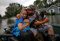 David Gonzalez comforts his wife Kathy after being rescued from their flooded home by Hurricane Harvey in Orange, Texas, U.S.A. on August 30, 2017.