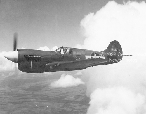 """The P-40, developed from the P-36, was America's foremost fighter in service when World War 2 began. P-40s engaged Japanese aircraft during the attack on Pearl Harbor and the invasion of the Philippines in December 1941. They also were flown in China early in 1942 by the famed Flying Tigers and in North Africa in 1943 by the first Army Air Force all-black unit, the 99th Fighter Squadron.  The P-40 served in numerous combat areas--the Aleutian Islands, Italy, the Middle East, the Far East, the Southwest Pacific and some were sent to Russia. Though often outclassed by its adversaries in speed, maneuverability and rate of climb, the P-40 earned a reputation in battle for extreme ruggedness. At the end of the P-40's brilliant career, more than 14,000 had been produced for service in the air forces of 28 nations, of which 2,320 were of the """"E"""" series. .Credit: U.S. Air Force via CNP"""