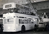 BNPS.co.uk (01202 558833)<br /> Pic: BearCrossBusCo/BNPS <br /> <br /> Back in the day - The vintage bus having its roof removed.<br /> <br /> A small group of volunteers have reintroduced a historic seaside bus service after spending five years restoring the original bus that travelled the route 50 years ago.<br /> <br /> The classic yellow open top 1965 Daimler Fleetline double decker is back running the old 'Route 12'  service between Bournemouth and Hengistbury Head.<br /> <br /> The volunteers drive and conduct the bus, as well as maintaining it and producing the timetables and bus stop flags.<br /> <br /> The vintage Bournemouth Corporation Transport bus ran along the idyllic five mile stretch of Dorset coastline from 1965 to 1977.<br /> <br /> But it had fallen into a 'sorry state' and was languishing in a depot when it was purchased by the volunteers from a bus operator in Purfleet, Essex, for £2,000 in 2014.