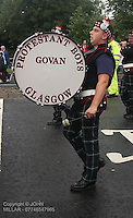 Bass Drummer with Govan Protestant Boys Flute Band with Govan District returning from the County Grand Orange Lodge of Glasgow Parade 2012 which took place in Glasgow on 7.7.12..