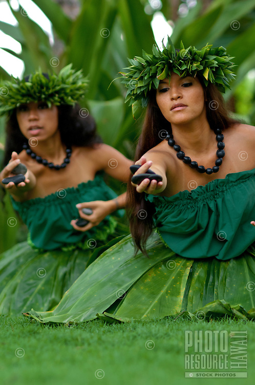 Hula kahiko dancers with 'ili'ili (stones used in hula) on Maui