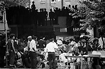 Notting hill Gate Carnival race riot, London W11 England 1976.Revellers take cover from the rioters. man trying to create calm.