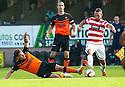 Dundee Utd's John Rankin challenges Hamilton's Dougie Imrie.