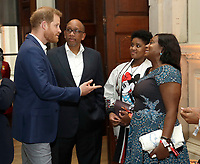 Prince Harry Duke of Cambridge speaks to Lesotho's Prince Seeiso, his wife Princess Mabereng Seeiso and daughter Princess Masentle Tabitha Seeiso during a reception for the concert hosted by his charity Sentebale at Hampton Court Palace, in London. The concert will raise funds and awareness for Sentebale, the charity founded by Prince Harry and Lesotho's Prince Seeiso in 2006, to support children and young people affected by HIV and AIDS in Lesotho, Botswana and Malawi. Photo Credit: ALPR/AdMedia