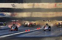 Nov 14, 2010; Pomona, CA, USA; NHRA top fuel dragster driver Larry Dixon (left) races alongside Shawn Langdon during the Auto Club Finals at Auto Club Raceway at Pomona. Mandatory Credit: Mark J. Rebilas-