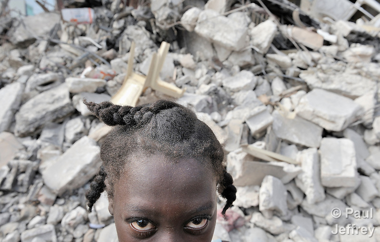 A girl stands in the devastated center of Port-au-Prince, Haiti, which was ravaged by a January 12 earthquake.