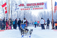 Hannah Mahoney leaves the start line at Knik during the start of the Junior Iditarod on Saturday February 25, 2017. <br /> <br /> <br /> Photo by Jeff Schultz/SchultzPhoto.com  (C) 2017  ALL RIGHTS RESVERVED