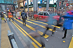 Hong Kong  Pedestrians hurry through a crosswalk in downtown Hong Kong.