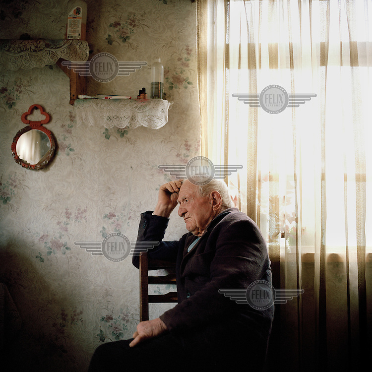 Ivan Djologua sits in the kitchen of his family home in the village of Tagiloni. Although in his mid 80's Ivan still works the land with his son Niko as they struggle to survive in Abkhazia's troubled Lower-Gali region on the border with Georgia Proper.