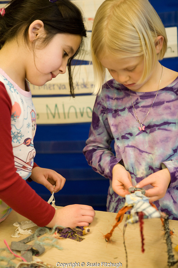 """Students at Kimball Elementary School, Seattle make creatures for an Arts Corps/Planet Arc sculptural piece celebrating the """"Seeds of Compassion"""" movement."""