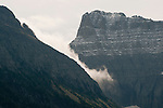 Early morning clouds and fog roll through Glacier National Park, Montana