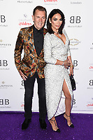 LONDON, UK. June 13, 2019: Duncan Bannatyne and Nigora Bannatyne arriving for Caudwell Butterfly Ball 2019 at the Grosvenor House Hotel, London.<br /> Picture: Steve Vas/Featureflash