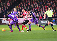 Lincoln City's Bruno Andrade gets between Port Vale's Antony Kay, left, and James Gibbons<br /> <br /> Photographer Andrew Vaughan/CameraSport<br /> <br /> The EFL Sky Bet League Two - Lincoln City v Port Vale - Tuesday 1st January 2019 - Sincil Bank - Lincoln<br /> <br /> World Copyright &copy; 2019 CameraSport. All rights reserved. 43 Linden Ave. Countesthorpe. Leicester. England. LE8 5PG - Tel: +44 (0) 116 277 4147 - admin@camerasport.com - www.camerasport.com