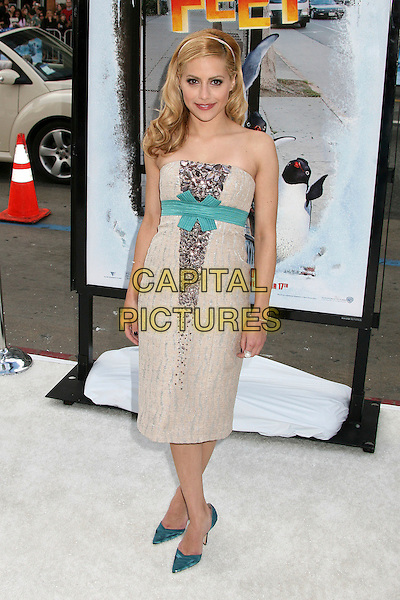 """BRITTANY MURPHY.World Premiere of """"Happy Feet"""" at Grauman's Chinese Theatre, Hollywood, California, USA..November 12th, 2006.Ref: ADM/BP.full length cream strapless turquoise bow sash jewel encrusted shoes .www.capitalpictures.com.sales@capitalpictures.com.©Byron Purvis/AdMedia/Capital Pictures."""
