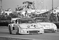 #11 Porsche 935 of Chuck Kendall, John Hotchkis and Bob Kirby battles the #89 Porche 934 of Jamsal, Kikos Fonseca and Alfredo Mena during the 12 Hours of Sebring, at Sebring Raceway, Sebring, FL, March 23, 1985.  (Photo by Brian Cleary/www.bcpix.com)