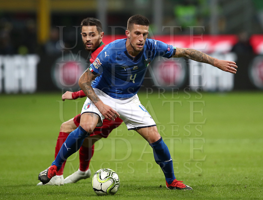 Football: Uefa Nations League Group 3match Italy vs Portugal at Giuseppe Meazza (San Siro) stadium in Milan, on November 17, 2018.<br /> Italy's Cristiano Biraghi (r) in action with Portugal's Bernardo Silva (l) during the Uefa Nations League match between Italy and Portugal at Giuseppe Meazza (San Siro) stadium in Milan, on November 17, 2018.<br /> UPDATE IMAGES PRESS/Isabella Bonotto<br /> <br /> UPDATE IMAGES PRESS/Isabella Bonotto