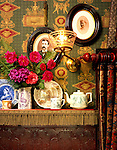 Portland, Oregon. c.1890.  Detail of the dining room plate rail, which holds a collection of Queen Victoria memorial china, and portraits of the homeowners' ancestors. The Lincrusta dado was painted a rich burgundy and highlighted to give the appearance of old tooled leather.
