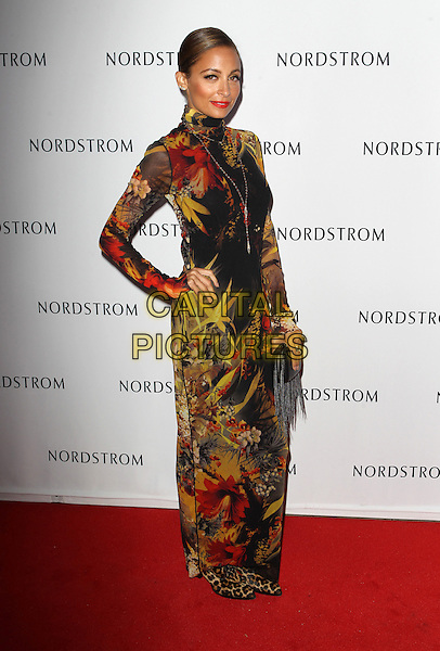 Nicole Richie<br /> Nicole Richie hosts grand opening of Nordstrom at The Americana at brand to benefit Ascencia And Hillsides held at Nordstrom at The Americana at Brand, Glendale, California, USA.<br /> September 17th, 2013<br /> full length yellow black red pattern print dress leopard print shoes high collar long sleeves clutch bag hand on hip<br /> CAP/ADM/KB<br /> &copy;Kevan Brooks/AdMedia/Capital Pictures