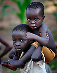 A boy carries his little brother in Karonga, a town in northern Malawi.