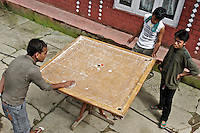 Yougsters playing a form of Nepalese pool in the small town of HIlle, Nepal, Annapurna Circuit.  Altitude: 1.475 mts.