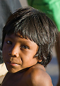Pará State, Brazil. Aldeia Pukararankre (Kayapo); smiling boy in the sunshine.