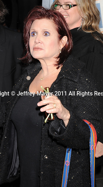 """HOLLYWOOD, CA - FEBRUARY 23: Carrie Fisher arrives for the Los Angeles Premiere of """"Hall Pass"""" at ArcLight Cinemas Cinerama Dome on February 23, 2011 in Hollywood, California."""