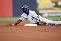 Tampa Yankees center fielder Jorge Mateo (14) slides into second base during a game against the Fort Myers Miracle on April 12, 2017 at George M. Steinbrenner Field in Tampa, Florida.  Tampa defeated Fort Myers 3-2.  (Mike Janes/Four Seam Images)