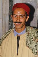 Tunis, Tunisia.  Muezzin of the Zeitouna Mosque, Ilyas bin Hmid Al-Alagi, wearing Traditional Tunisian Hat, a Chechia.