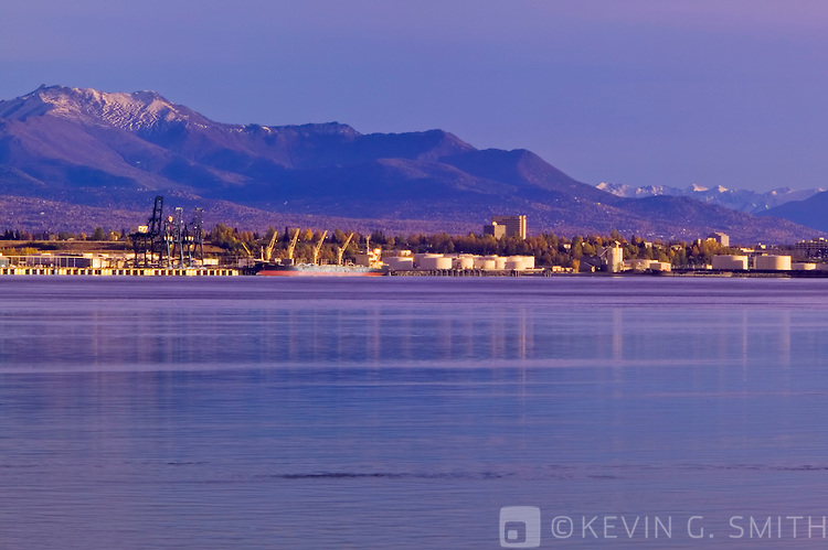 View of the port of Anchorage from across Knik Inlet, shot from the port at Point Mckensie. Kenai mountains in background. Fall, Anchorage Alaska.