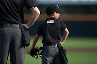 Vincent Stio stands next to home plate umpire Austin Jones prior to the start of the Carolina League game between the Winston-Salem Dash and the Buies Creek Astros at Jim Perry Stadium on August 15, 2018 in Buies Creek, North Carolina.  The Astros defeated the Dash 5-0.  (Brian Westerholt/Four Seam Images)