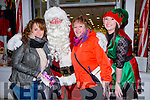 Enjoying a wonderful evening of festive cheer at CH Chemist on Friday evening here with Santa and Helper were l-r  Yvonne Cronin, Gallowsfield and Rosarie Cronin, Gallowsfield, Tralee